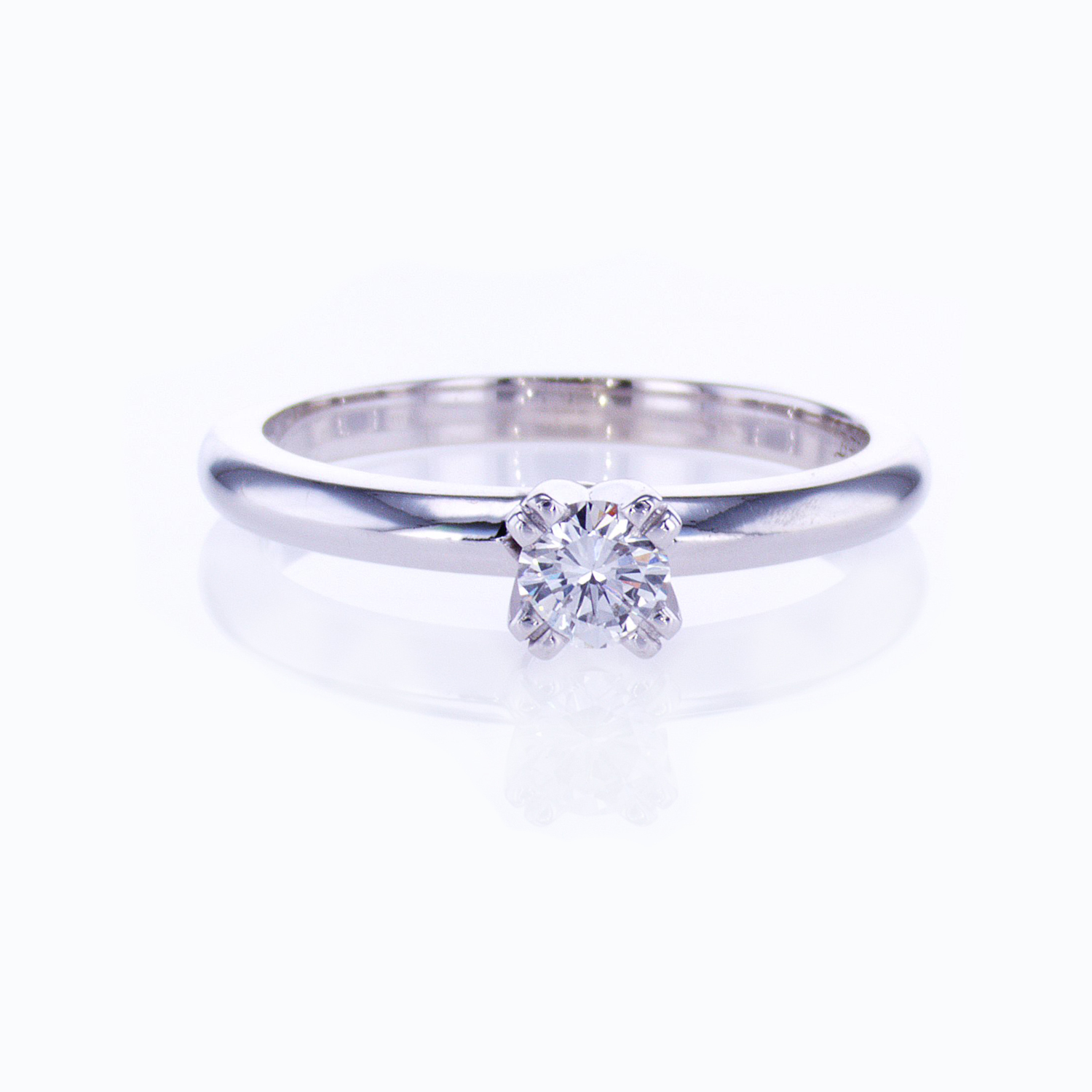 Classic Four-prong Solitaire Engagement Ring and Diamond