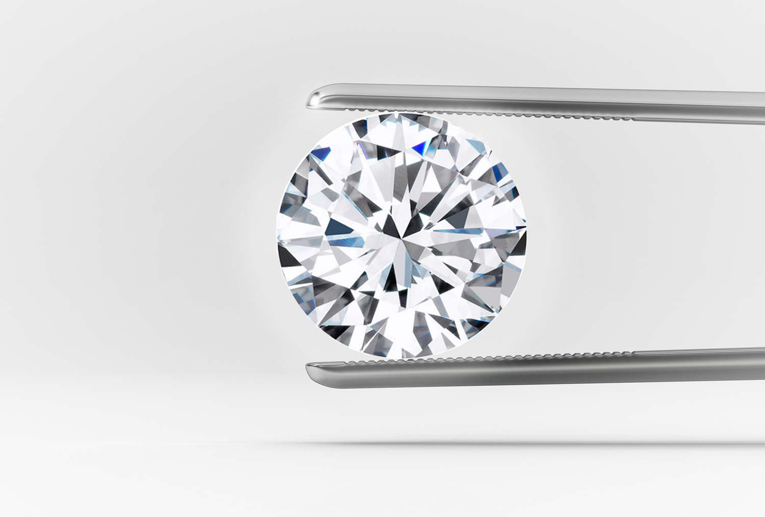 a round diamond in tweezers